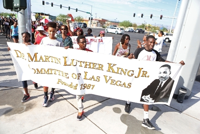 Members of the community march north on Martin Luther King Blvd. on Saturday.