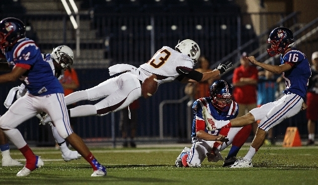 Santiago Nieto (13) of Salpointe (Ariz.) Catholic leaps to block a 20-yard field-goal attempt by Liberty kicker Austin Fitzgerald during the first quarter of the Sollenberger Classic on Saturday n ...