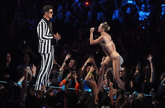 """Robin Thicke, left, and Miley Cyrus perform """"Blurred Lines"""" at the MTV Video Music Awards Sunday at the Barclays Center in Brooklyn, N.Y. (Charles Sykes/Invision/The Associated Press)"""