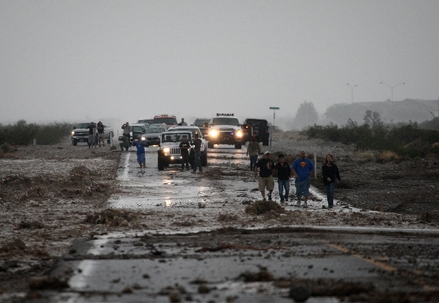 A flooded portion of Kyle Canyon Road blocks people from leaving Mount Charleston on Sunday.