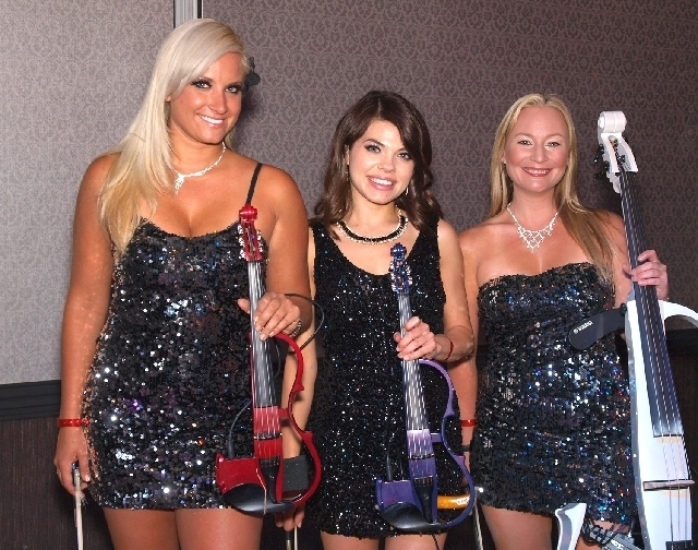 Ashley Korak, from left, Christina Riegert and Rachael Brown of Bella Electric Strings