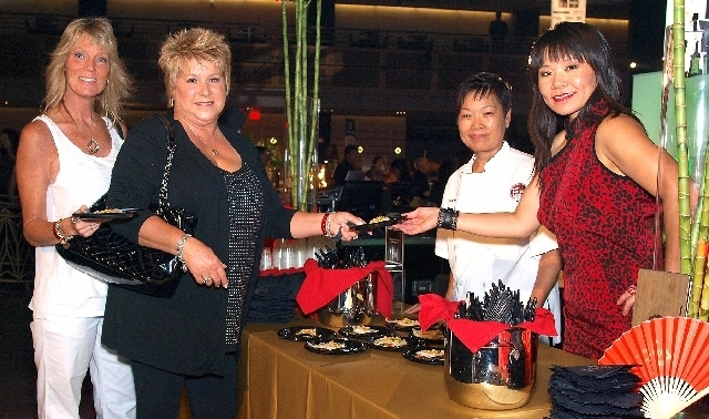 Suzanne Miele, from left, Candice Nicola, Ming See Woo and Theresa Woo