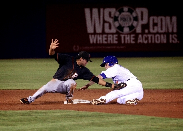 Fresno Grizzlies shortstop Ydwin Villegas tags out Brian Bixler of the 51s at second base during the fifth inning Sunday at Cashman Field. Bixler was caught off first base by pitcher Eric Surkamp, ...