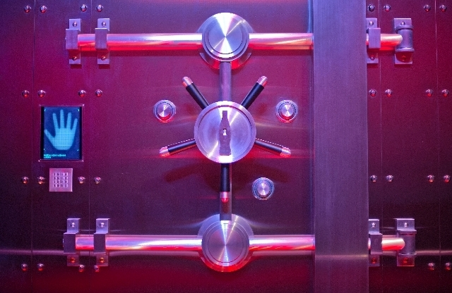 """In this Friday, Aug. 9, 2013 photo, the vault containing the """"secret recipe"""" for Coca-Cola stands on display at the World of Coca-Cola museum, in Atlanta. The 127-year-old recipe for Coke sits i ..."""