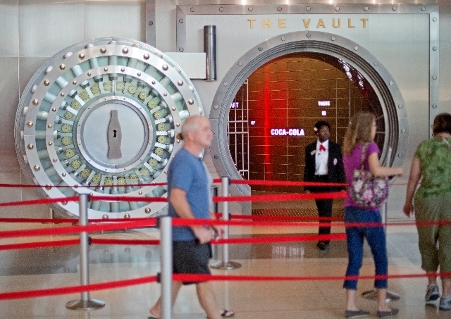 """In this Friday, Aug. 9, 2013 photo, a tour group enters the vault exhibit containing the """"secret recipe"""" for Coca-Cola at the World of Coca-Cola museum, in Atlanta. The 127-year-old recipe for C ..."""