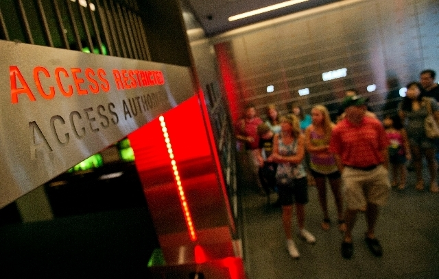 """In this Friday, Aug. 9, 2013 photo, the vault containing the """"secret recipe"""" for Coca-Cola is unveiled to viewers taking a tour at the World of Coca-Cola museum, in Atlanta. The 127-year-old rec ..."""