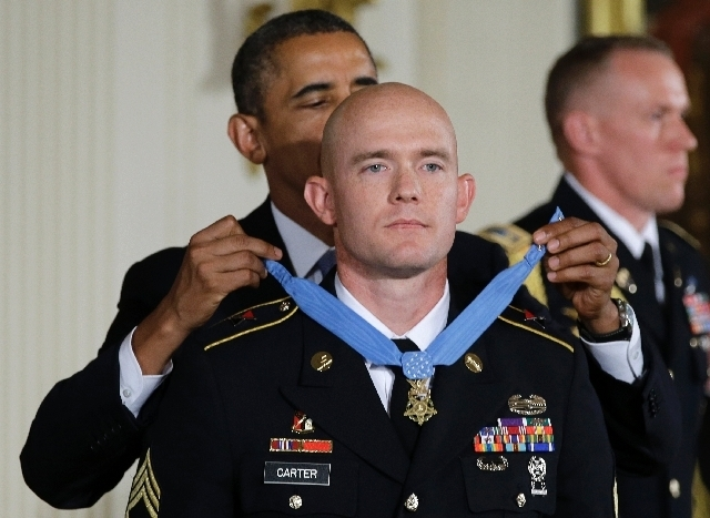 President Barack Obama awards U.S. Army Staff Sgt. Ty M. Carter the Medal of Honor for conspicuous gallantry during a ceremony Monday in the East Room of the White House in Washington. Carter rece ...
