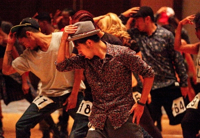 """Tsuyoshi Takayama, center, dances to """"Beat It"""" by Michael Jackson during auditions for """"Michael Jackson One"""" at Red Rock Resort during the 2013 World Hip Hop Dance Championship weekend. A pool ..."""