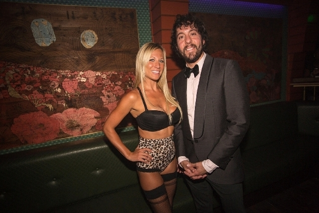 """Jonathan Kite of """"2 Broke Girls"""" had fun partying with friends and this lady in interesting clothing last Saturday at The Act club in the Palazzo."""