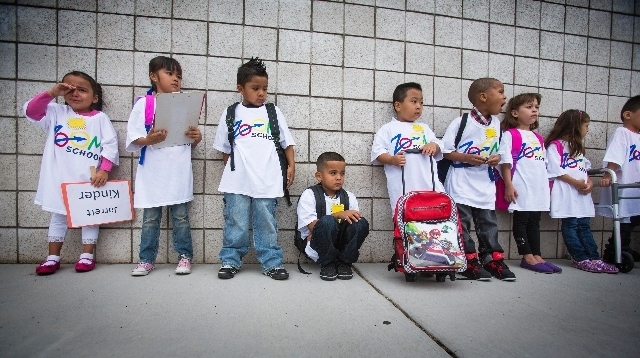 Kindergarten students stand in line before the start of the first day of school at Cambeiro Elementary School at 2851 E. Harris Avenue on Monday. Cambeiro is one of 14 Clark County elementary scho ...