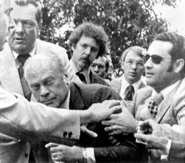 "President Gerald Ford is shielded by the Secret Service after an assassination attempt by Lynette ""Squeaky"" Fromme on Sept. 15, 1975, in Sacramento, Calif. A federal judge has allowed the releas ..."
