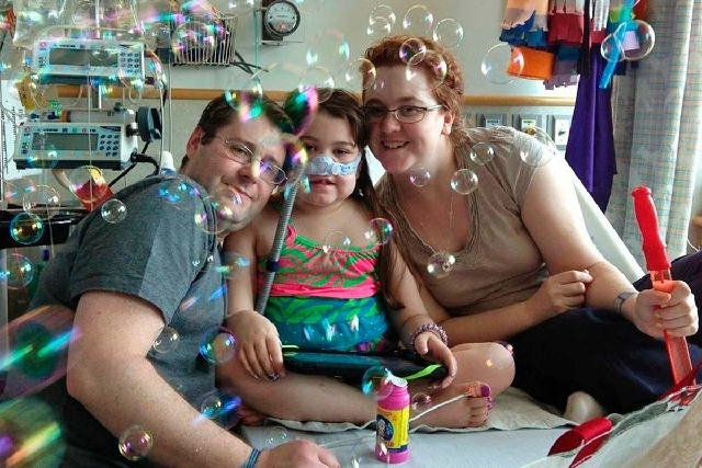 Sarah Murnaghan, center, celebrates the 100th day of her stay in Children's Hospital of Philadelphia with her father, Fran, left, and mother, Janet in this May 30 photo. The 10-year-old suburban  ...