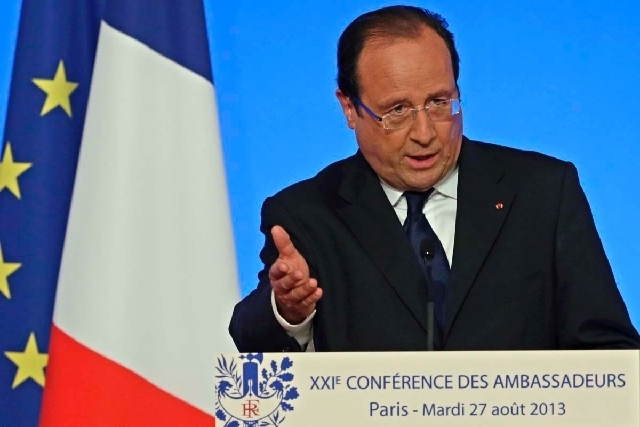 French President  Francois Hollande delivers his speech during a conference with France's ambassadors, at the Elysee Palace, in Paris, Tuesday Aug. 27, 2013. Francois Hollande said France is prep ...