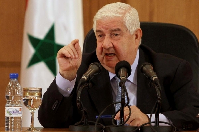 Syrian Foreign Minister Walid al-Moallem speaks during a press conference in Damascus, Syria on Tuesday, August 27, 2013. Syria's foreign minister said Tuesday his country would defend itself usi ...
