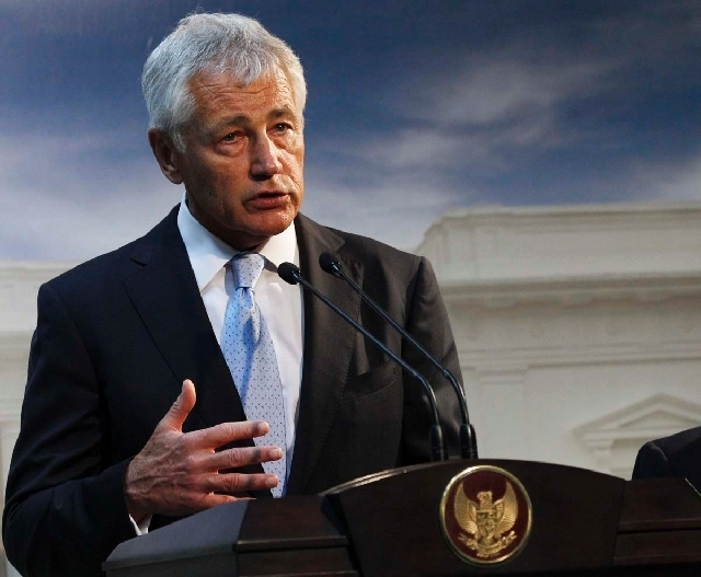 Defense Secretary Chuck Hagel, shown speaking in Jakarta, Indonesia, on Monday, said today that U.S. forces are now ready to act on any order by President Barack Obama to strike Syria. The U.S. Na ...