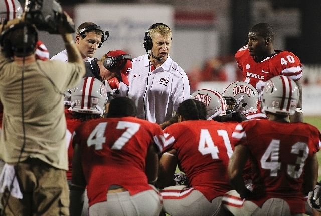 UNLV coach Bobby Hauck addresses his team before the second overtime period during its 30-27 triple-overtime loss to Minnesota in last year's season opener at Sam Boyd Stadium. The Rebels, who we ...