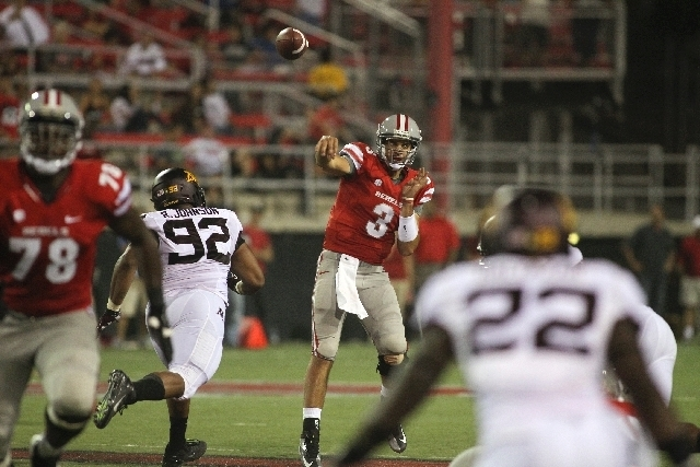 UNLV quarterback Nick Sherry throws over Minnesota defensive tackle Roland Johnson (92) during the Rebels' 30-27 triple-overtime loss in last year's season opener. Making his first Rebels start, ...