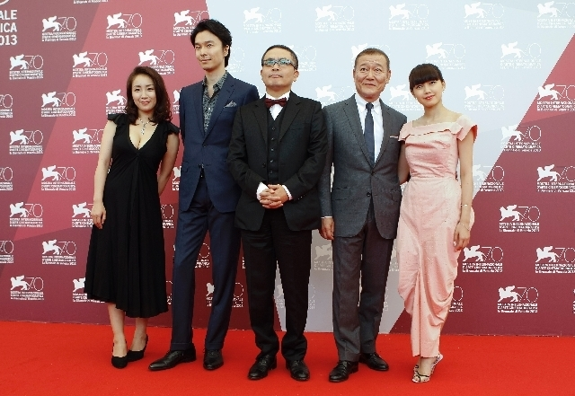 The cast of the movie 'Why Don't You Play In Hell', from left, actors Megumi Kagurazaka, Hiroki Hasegawa, director Sion Sono, actors Jun Kunimura and Fumi Nikaido pose during a p ...