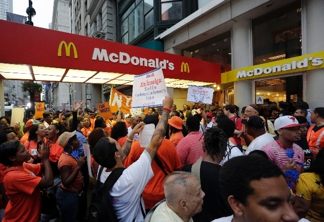 Protesting fast-food workers demonstrate Thursday outside a McDonald's restaurant on Fifth Avenue in New York City. (The Associated Press)