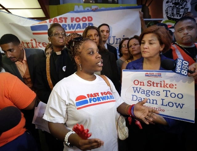 Shaniqua Davis speaks at a fast-food workers' protest Thursday outside a McDonald's restaurant on Fifth Avenue in New York City. She works at a McDonald's, earning $7.25 a hour. (The Associated ...