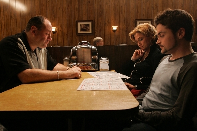 """This undated photo provided by HBO, shows, from left, actors James Gandolfini as Tony Soprano, Edie Falco as Carmela and Robert Iler as Anthony Jr. in a scene from the finale of, """"The Sopranos."""""""