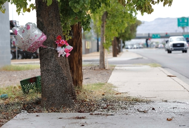 A makeshift memorial on a tree is shown on Thursday in Phoenix. (Matt York/The Associated Press)