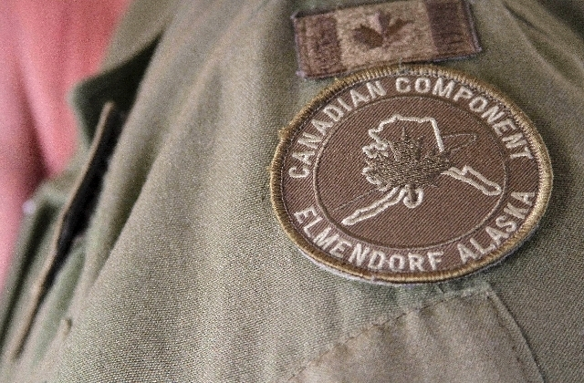 A photo made Tuesday, Aug. 27, 2013, shows the NORAD patch worn by Col. Patrick Carpentier, deputy commander of the NORAD Alaska Region, who was on a plane that was hijacked for a simulation to te ...