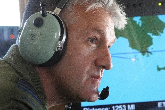 A photo made Tuesday, Aug. 27, 2013, shows Col. Patrick Carpentier, deputy commander of the NORAD Alaska Region, on a plane that was hijacked during a simulation to test the response of NORAD and  ...