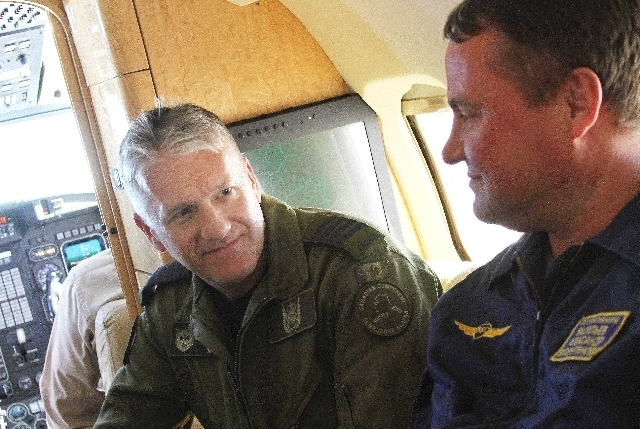 In a phoito made Tuesday, Aug. 27, 2013,  Col. Patrick Carpentier, left, deputy commander of the NORAD Alaska Region, speaks with Russian Federation Air Force Col. Alexander Vasiliev on a plane th ...