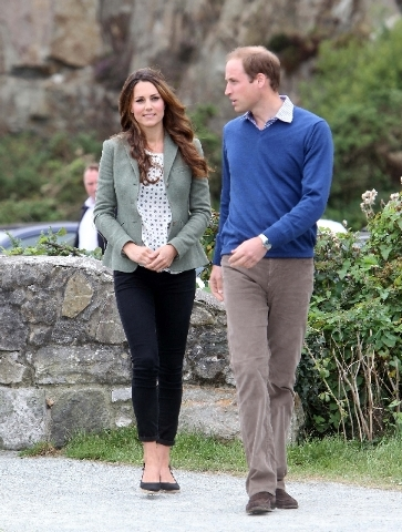 Britain's Duke and Duchess of Cambridge arrive on Friday at Breakwater Country Park for the start of the Ring O' Fire Anglesey Coastal Ultra Marathon in Anglesey, Wales. (Paul Lewis/The Associat ...