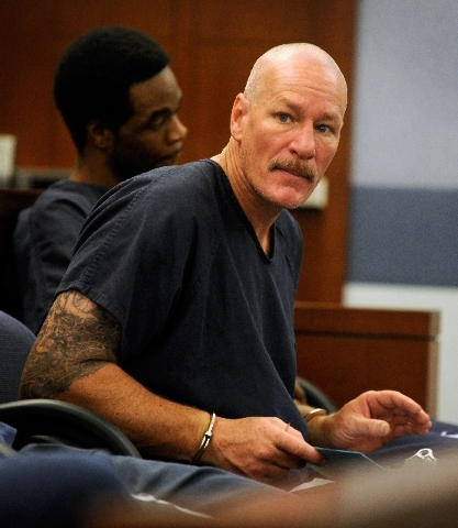 Richard Schlacta sits with other inmates Friday morning before making his first appearance before Justice of the Peace Joseph Sciscento at the Regional Justice Center. Schlacta is charged with sex ...
