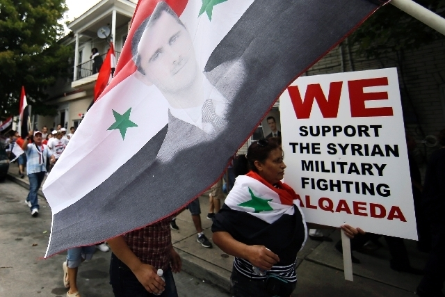 Members of the local Syrian community march in protest against the United States' involvement in Syria, Friday, Aug. 30, 2013, in Allentown, Pa. President Barack Obama says he hasn't made a fina ...