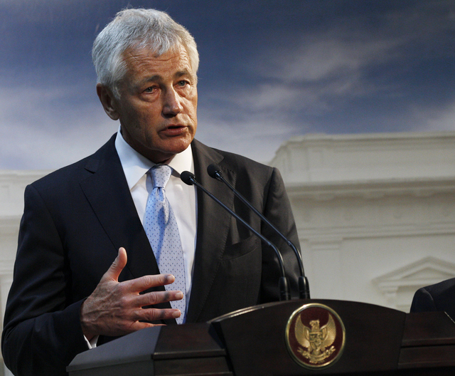 Defense Secretary Chuck Hagel, shown speaking Monday in Jakarta, Indonesia, said Tuesday that U.S. forces are now ready to act on any order by President Barack Obama to strike Syria. (AP Photo/Ach ...