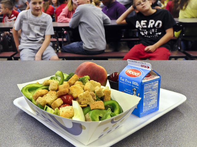 A select healthy chicken salad school lunch, prepared under federal guidelines, sits on display on Sept. 11, 2012, at the cafeteria at Draper Middle School in Rotterdam, N.Y. After just one year,  ...