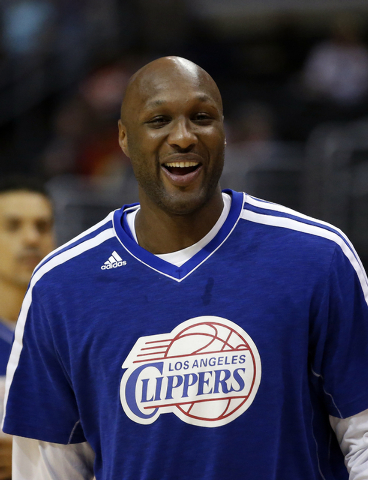 FILE - In this March 13, 2013, file photo, Los Angeles Clippers' Lamar Odom smiles during NBA basketball practice in Los Angeles. Odom was arrested for allegedly driving under the influence early  ...
