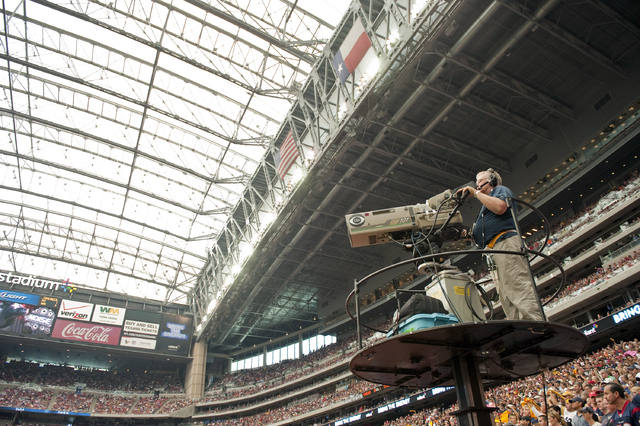Dave Einsel/The Associated Press In this Oct. 2, 2011, file photo, a CBS cameraman works during the second quarter of an NFL football game between the Pittsburgh Steelers and Houston Texans in Hou ...
