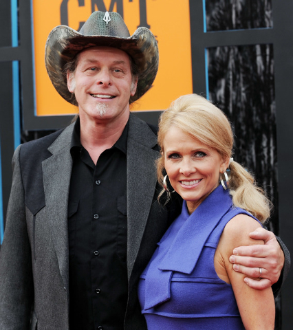 FILE- In this June 16, 2009, file photo, musician Ted Nugent and wife, Shemane Ann Nugent, arrive at the CMT Music Awards in Nashville, Tenn. Shemane Nugent has been arrested after a handgun was f ...