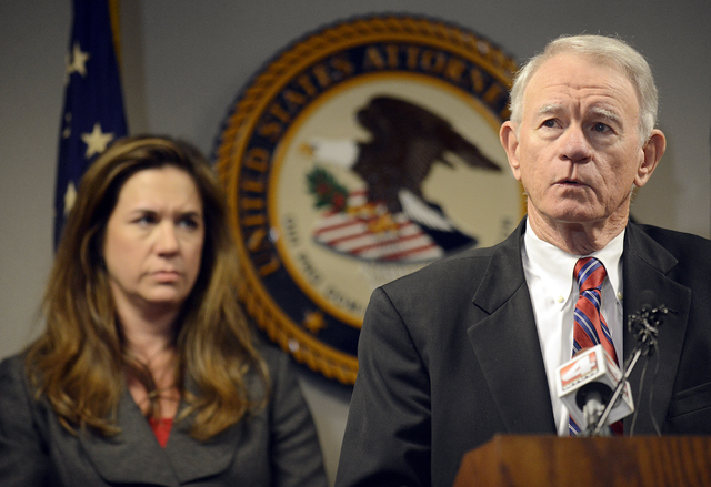 U.S. Attorney George Beck speaks at a news conference on Monday, Aug. 26, 2013, at the U.S. District Attorney's Office in Montgomery, Ala. A federal and state investigation into dog fighting and g ...