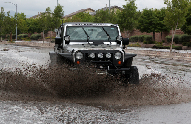 A Jeep goes drives through flood waters on Grand Teton drive in the northwest part of the valley on Monday, August 26, 2013. (Justin Yurkanin/Las Vegas Review-Journal)