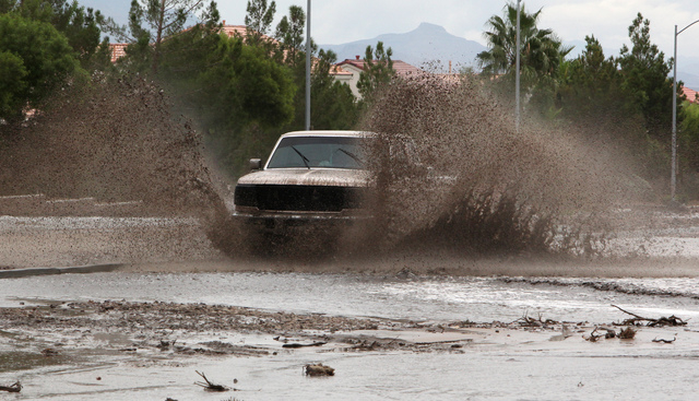 A truck drives through flood waters on Grand Teton drive in the northwest part of the valley on Monday, August 26, 2013. (Justin Yurkanin/Las Vegas Review-Journal)