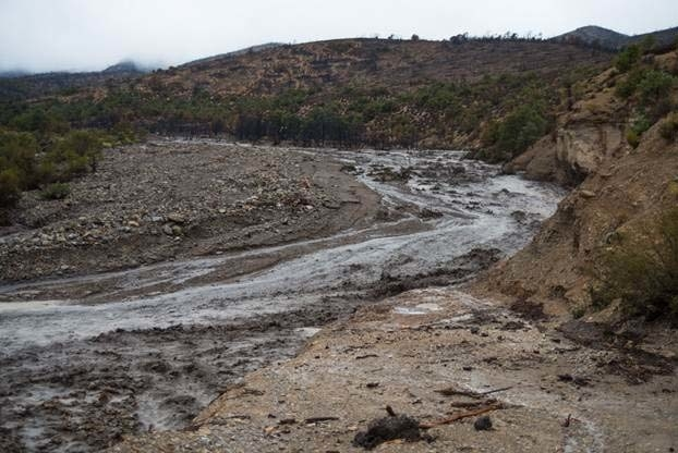 A torrent of floodwater is shown near Harris Springs Road on Sunday near Kyle Canyon Road. (Michael Balen/USDA Forest Service)