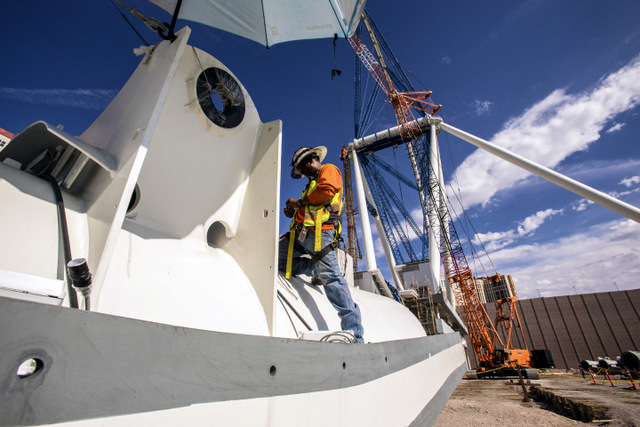 Electrician Kroby Pancham works on a section of the High Roller Observation Wheel at The Linq on Friday, Aug.23, 2013.The 550-foot tall ferris wheel will be the tallest in the world. It is schedul ...