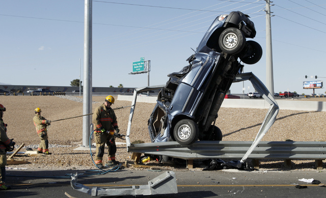 An SUV stands on end after an accident on an the off ramp of US 95 southbound at Jones Blvd. Wednesday, May 15, 2013.  The driver of the car was taken to the hospital. (John Locher/Las Vegas Revie ...