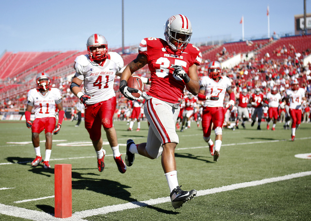 UNLV's Tim Cornett (35) runs into the end zone for a touchdown in front of New Mexico's Dallas Bollema (41) during a game at Sam Boyd Stadium on Nov. 3, 2012. (Jason Bean/Las Vegas Review-Journal)