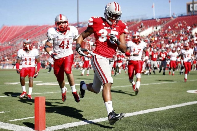 UNLV's Tim Cornett (35) runs into the end zone for a first half touchdown in front of New Mexico's Dallas Bollema (41) during their football game at Sam Boyd Stadium in Las Vegas on Nov. 3, 2012.  ...