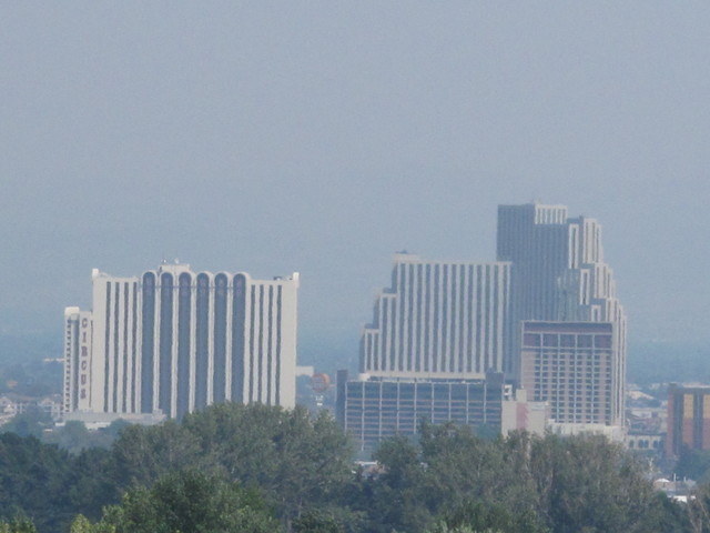 From the hills on the west edge of Reno, a smoky haze from the Rim Fire burning more than 150 miles away at Yosemite National Park is seen Monday, Aug. 26, 2013, over the downtown casino district. ...