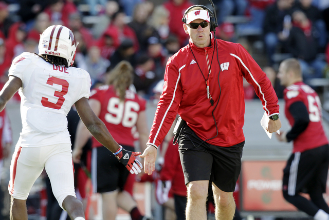 FILE - In this April 20, 2013, file photo, Wisconsin  head coach Gary Andersen, right, encourages wide receiver Kenzel Doe (3) during their spring NCAA college football game at Camp Randall Stadiu ...