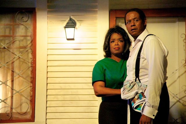 """FILE - This undated file film image provided by The Weinstein Company shows Oprah Winfrey as Gloria Gaines, left, and Forest Whitaker as Cecil Gaines in a scene from """"Lee Daniels' The Butler."""" (AP ..."""