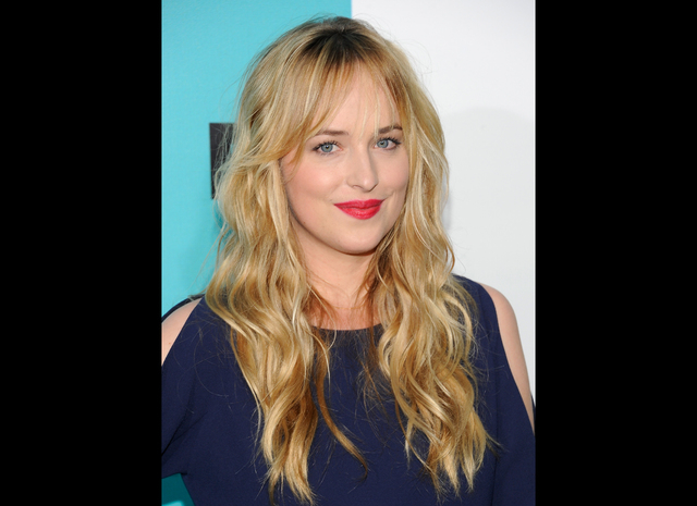 Dakota Johnson attends the FOX network upfront presentation party at Wollman Rink, in New York in a May 14, 2012 file photo. Focus Features and Universal Pictures announced Monday that Dakota John ...