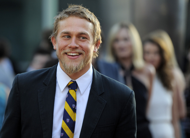 """In a Tuesday, Aug. 30, 2011 file photo, Charlie Hunnam, a cast member in """"Sons of Anarchy,"""" arrives at a screening of the fourth season premiere of the television series, in Los Angeles.  Focus Fe ..."""
